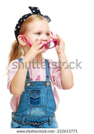Little girl trying on glasses.Childhood education development in the Montessori school concept. Isolated on white background.