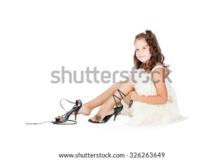 little girl trying the big shoes on
