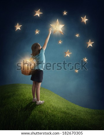 Little girl  trying to catch a star - stock photo