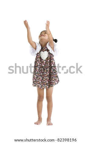 little girl trying to catch something, isolated on white background - stock photo