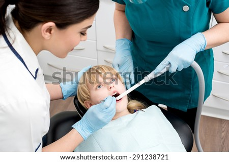 Little girl under dental treatment at clinic