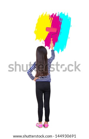 Little girl use paint roller painting the wall - stock photo