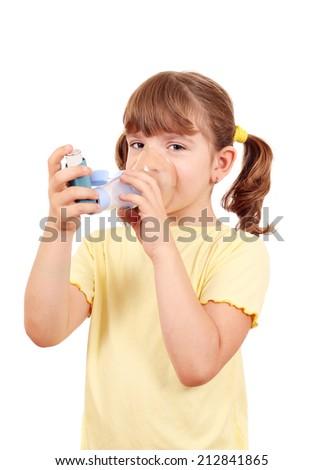 little girl using an asthma inhaler  - stock photo