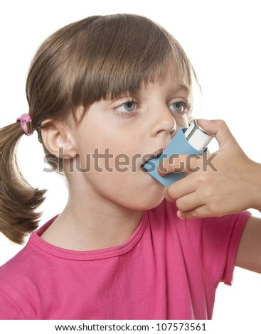 little girl using inhaler - respiratory problems isolated on white background