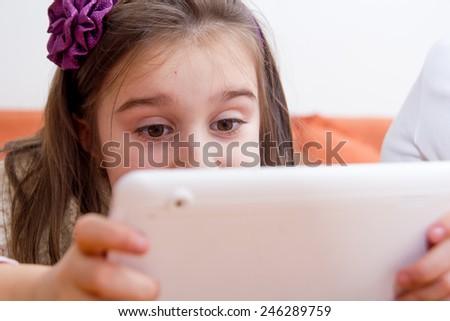 Little girl using tablet - stock photo