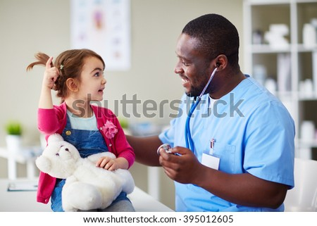 Little girl visiting her doctor at hospital - stock photo