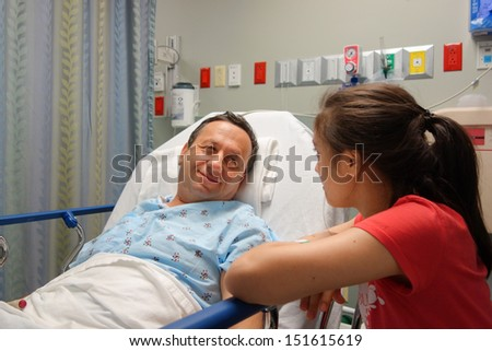 Little girl visits her father before the surgery - stock photo