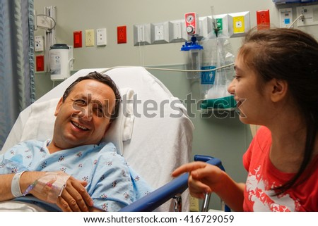 Little girl visits her father before the surgery