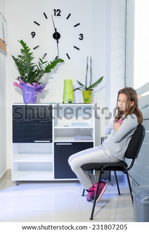 Little girl waiting at the dentist - stock photo