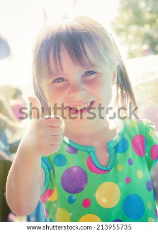 Little girl walking in the park in the summer. - stock photo