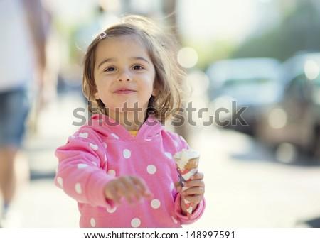 Little Girl Walking With Ice Cream - stock photo