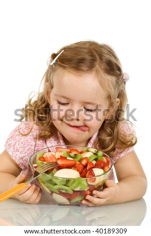 Little girl wants to taste the fruit salad - isolated - stock photo