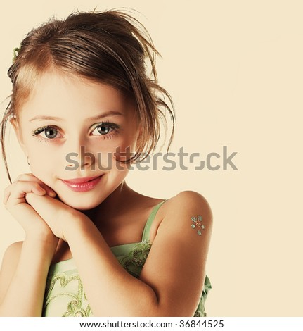 little girl. warm yellow tones. - stock photo