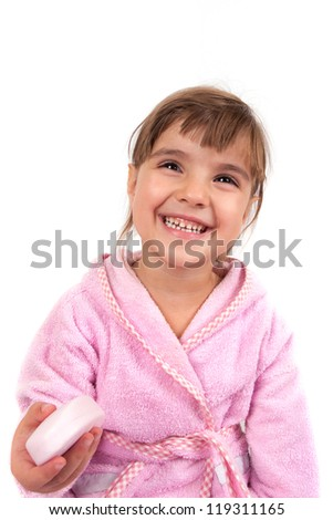 Little girl washing hand and face - stock photo