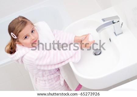 Little girl washing hands - stock photo
