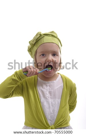 little girl washing her teeth on white background