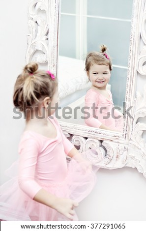Little girl wearing a ballet tutu getting ready for her ballet lesson