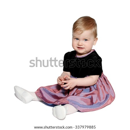 Little girl wearing a beautiful dress on white background - stock photo