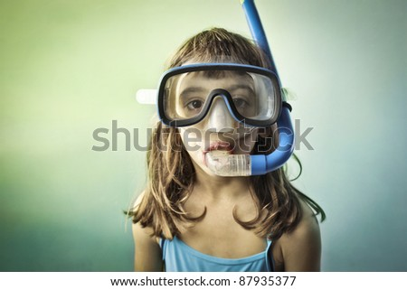 Little girl wearing a diving mask - stock photo