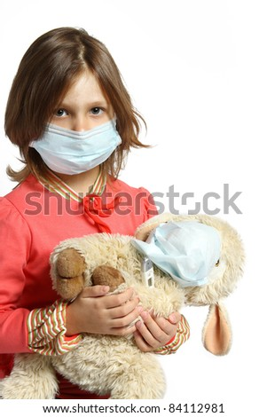 Little girl wearing a protective mask with thermometer