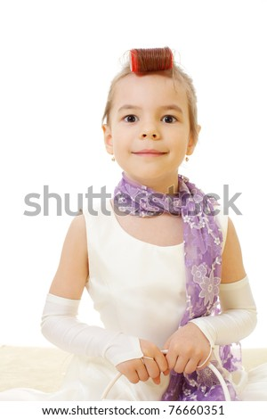 Little girl wearing ball cream dress and red roller in her hair wanting go to dance.