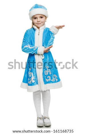 Little girl wearing blue suit of snow maiden standing in full length holding blank copy space on her open palm, over white background - stock photo