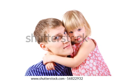 little girl wearing dress is embracing her father. father looking away. isolated.