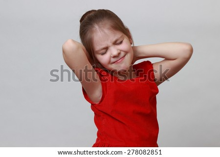 Little girl wearing fashion red dress and dancing - stock photo