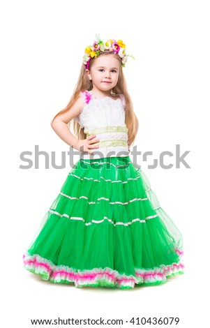 Little girl wearing fluffy dress posing with a wreath on her head. Isolated - stock photo