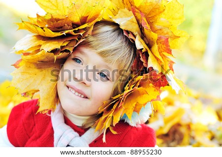 little girl wearing foliage wreath in fall time - stock photo