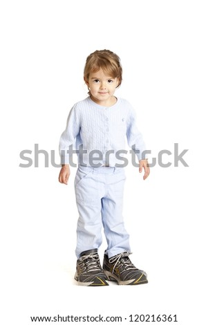 little girl wearing her dad's shoes, clipping path included