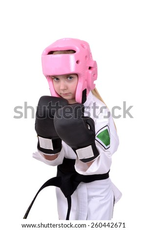 little girl wearing karate sparring gear isolated white background