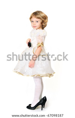 little girl wearing like a princess but with mother's shoes - stock photo