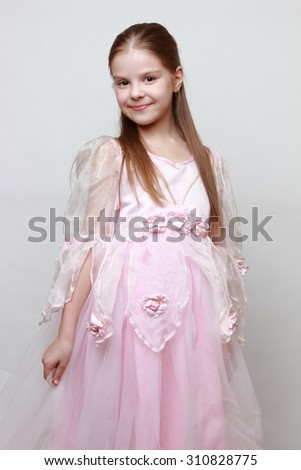 Little girl wearing pink dress as a princess - stock photo