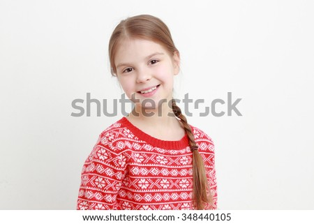 little girl wearing red sweater on Christmas - stock photo