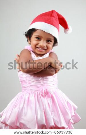 Little girl wearing  santa hat - stock photo