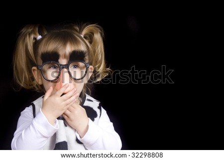 Little girl wearing silly mustache disguise - stock photo