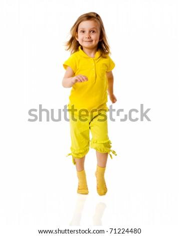 Little girl wearing yellow walking isolated on white - stock photo
