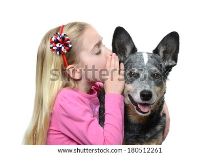 little girl whispering to her dog - stock photo