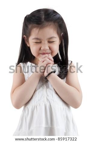 Little girl wishing on white background - stock photo