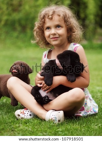 Little girl wit puppy - stock photo