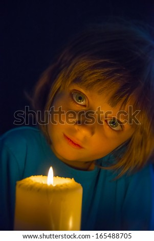 little girl with a big candle - stock photo
