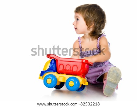 little girl with a big car on white background