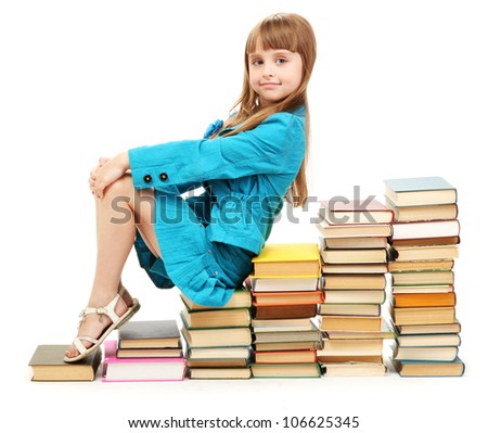 little girl with a books isolated on white