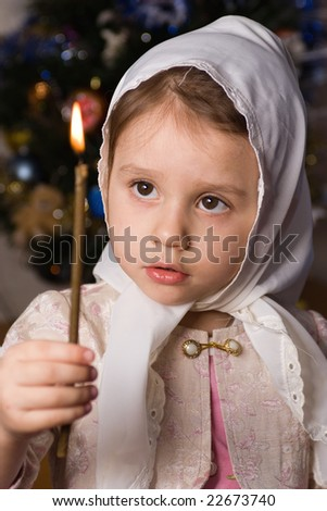little girl with a candle - stock photo