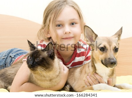 little girl with a cat and a dog - stock photo