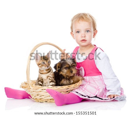 little girl with a cat and a dog sitting in a basket. isolated on white background - stock photo