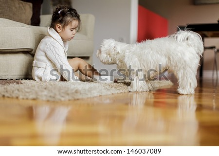 Little girl with a dog - stock photo