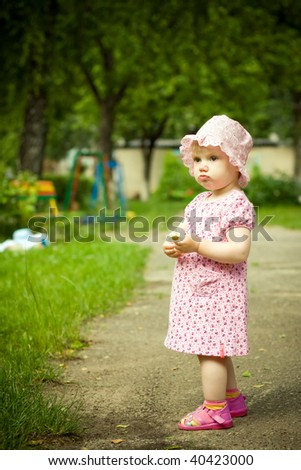 little girl with a flower - stock photo