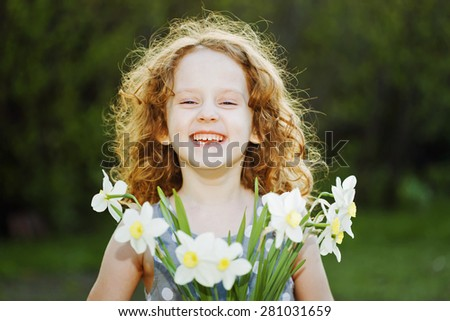 Little girl with a flower in her hand. Mothers day concept. - stock photo